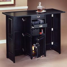 The Bar Provides Generous Storage With A Cabinet Two Utility Drawers A Bar Glass
