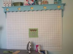 Homemade roll up design wall placed under a shelf like valance for under $50.  Like!  Want!