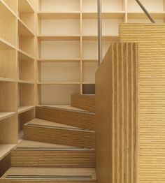 Plexwood® Rietveldplan house detail of a staircase with wall in matching deal edge plywood fineline veneers