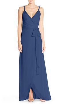 This gorgeous chiffon gown offers elegant flattery and customizable comfort with wrapped styling that creates a plunging V-neckline and a graceful tulip hem.