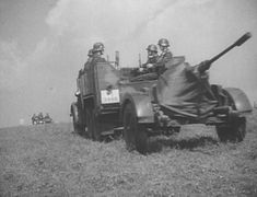 German 2 cm FlaK 38 gun being towed by a Krupp Protze Kfz. 81 truck, circa 1939