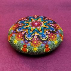 My mandala stones are hand painted and protected with two coats of matte vanish. They are not suitable for outdoor use however. The smooth surface of these stones is the perfect surface to paint on and I can think of no better subject than beautiful, colorful mandalas.  Slightly larger than my standard mandala stone, this mandala is between 3.0 and 3.5 diameter and is a little over 1 deep. But as usual, there is no mass production. They are ALL one of a kind.  International shipping now…