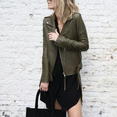 Olive biker jacket & black shirt dress | @styleminimalism