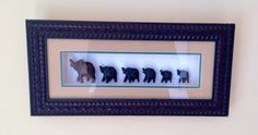 Wood Carvings in Shadow Box Frame - Elephants: This Beautiful Artisan Crafted Six Lucky Elephants with their trunks up, are handmade and framed in an artisan crafted wood frame shadow box with a beige color matting.