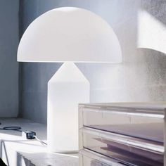 White Atollo table lamp by Oluce. Available on Lumigado.com