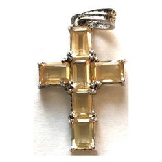 Vintage Citrine Sterling Cross Pendant Emerald cut citrine stones set in 925 Sterling silver. Measures one inch. Nice sparkle, does not show up well on white background to show it in the photo. They have nice clarity. Very pretty Pendant. Vintage Jewelry Necklaces