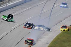 2017 NASCAR Wrecks - November 19, 2017:  NASCAR: ALABAMA 500 -  Monster Energy NASCAR Cup Series driver Jamie McMurray (1) collides with Mark Thompson (15) during the Alabama 500 at Talladega Superspeedway.