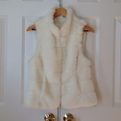 White Faux fur vest Used a couple of times. Will fit S/M. 2 front pockets. Jackets & Coats Vests