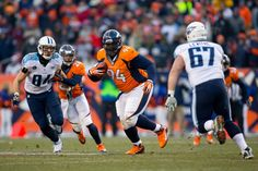Defensive tackle Terrance Knighton #94 of the Denver Broncos runs with the ball after catching an interception as tight end Taylor Thompson #84 and guard Andy Levitre #67 of the Tennessee Titans look to make the tackle during the third quarter at Sports Authority Field Field at Mile High on December 8, 2013 in Denver, Colorado. The Broncos defeated the Titans 51-28.