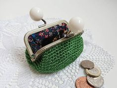 Vintage white bubble clasp frame coin purse handmade from green silky sheen luxury yarn and fully lined with adorable Liberty of London floral fabric. Super cute and stylish purse 👛