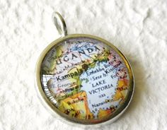 World Traveler Map Necklace or Pendant  by TheGreenDaisyShop, $20.00