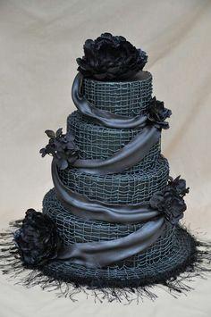 black wedding cake www.tablescapesbydesign.com https://www.facebook.com/pages/Tablescapes-By-Design/129811416695