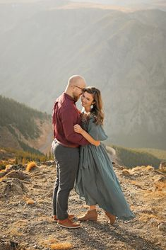 Fall Engagement Session - Red Lodge - Montana - Beartooth Pass - Beartooth Highway - Man - Woman - Engaged - Couple - Fiancé - Outdoor - Overlook - Mountains - Trees - Rocks - Maroon Dress Shirt - Burgundy Dress Shirt - Gray Pants - Gray Jeans - Blue Dress - Teal Dress - Sunset - Montana Wedding Photographer - Sara Nagel Photography Fall Engagement, Engagement Couple, Engagement Session, Engagement Photos, Couple Photography, Engagement Photography, Maroon Dress Shirt, Red Lodge Montana, Beartooth Highway