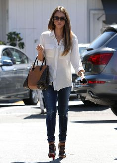 Casual : crisp white button up, ripped skinny jeans, and caged heels