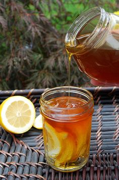 lemon-honey tea base: Slice lemons up and pack them into a jar.  Pour honey (preferably local, of course) over the lemons. Close jar. Refrigerate.  When you are feeling sniffly, or chilly, or just want a warm cup of goodness,  take a dollop of honey-tea base and pour boiling water over it.