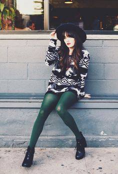 Green tights and oversized sweater for the weather