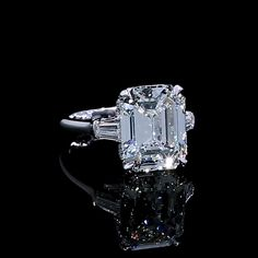 A handcrafted one of a kind beauty, Halle glistens in the light from every angle. #jeandousset #youaboveall #threestonering #emeraldcut #emeraldcutdiamonds Harry Winston Engagement Rings, Three Stone Engagement Rings, Three Stone Rings, Engagement Ring Settings, Vintage Engagement Rings, Types Of Diamonds, Dream Ring, Diamond Rings, Marie