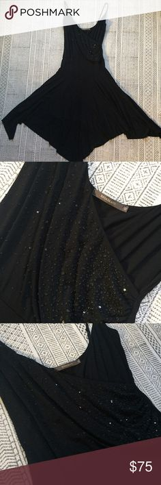 River Island Black Dress w/ Sequins Now THIS is a party dress 🎉🎉. The raw and asymmetrical hemline means this dress moves like a dream on the dance floor and is SUPER comfortable. The illusion wrap top is detailed with black sequins on one side. It is marked as a size 12, however I believe it fits more like an 8/10. The straps are adjustable. All reasonable offers welcome! River Island Dresses Asymmetrical