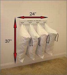 Wall-mounted laundry sorter.  Creates more space in a small laundry room and makes it so easy to clean the floor!!! Diy and save alot of money!! Next on the TO DO list!