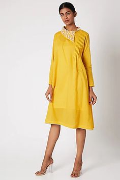 Featuring a yellow tunic in mul cotton and dobby base with textured sleeves. It has gold zari, and velvet cut hand embroidered collar. FIT: Fitted at bust. CARE: Dry clean only. Kurtha Designs, Tunic Designs, Kurta Designs Women, Kurti Neck Designs, Dress Neck Designs, Collar Designs, Designer Party Wear Dresses, Kurti Designs Party Wear, Indian Fashion Designers