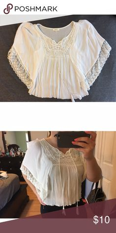 Small flowy shirt NWOT Never worn, perfect condition! Comes right about to the waist. Forever 21 Tops Blouses