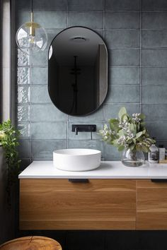 Denman Prospect Residence - Studio Black Interiors A modern ensuite, with black fixtures, floating timber and stone vanity, and sage green tiles. Built by Homes by Howe. Photography by HCreations.