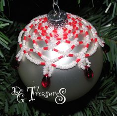 """Christmas Ball Drape 01 - $15+ S*H -- This Christmas Ball Drape has a combination of matte white beads, matte red bugles, and 4mm red teardrops all formed together in a drape design and draped over a matte silver 2 5/8"""" Christmas Ball."""