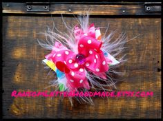 Tiny #Birthday Bow Mulitcolor Bubble Dot Great for babies, toddlers, or pups! Rainbow Bubble Dot ribbon is under hot pink ruffle ribbon, hot pink polka dot and a touch of #marabou #feather! Centered with a violet jewel by ransomletterhandmade