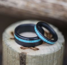 Matching black wedding rings with hand-crushed turquoise inlays, handcrafted by Staghead Designs.