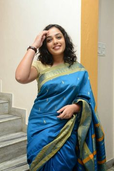 Nithya Menen is an Indian film actress and playback singer, who works in the South Indian film industries. Nithya Menen was born in Banglo. South Indian Actress, Beautiful Indian Actress, Beautiful Actresses, Nithya Menen, Sleeveless Outfit, Stylish Girl Pic, Saree Dress, Indian Celebrities, Indian Beauty Saree