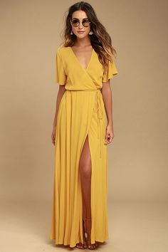 We're forever grateful we found the Much Obliged Golden Yellow Wrap Maxi Dress! Gauzy woven rayon drapes into a sultry surplice bodice, framed by fluttering short sleeves. Wrapping maxi skirt secures via hidden, internal ties and an adjustable waist tie. #Yellow