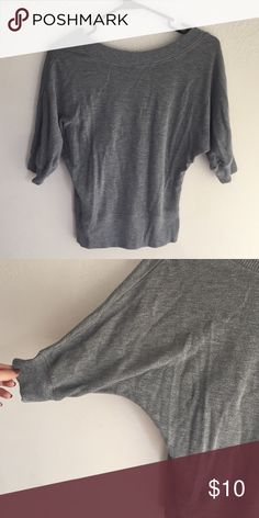 Tapered waist and slouched arm sweater Tapered waist with slouched arms . No holes or stains , very comfy for a put together but yet a laid back look Sweaters