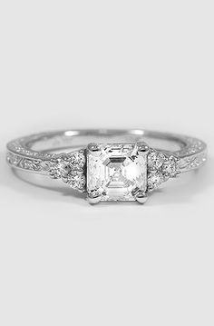 ADORNED TRIO DIAMOND RING Looks like mine but I have the triangular (Trillions it think) shaped diamonds on the side of my princess cut