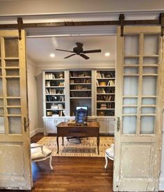 Beautiful office with rolling barn doors - part of this  farmhouse tour eclecticallyvintage.com