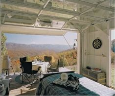 Architect Jeffery S. Broadhurst designed and built this retreat for his family on a very remote mountaintop property in West Virginia, USA. The front wall is an overhead-acting aluminum and glass garage door, opening to a cantilevered deck. Tiny Spaces, Small Apartments, Open Spaces, Glass Garage Door, Garage Doors, Barn Doors, Garage Windows, Big Windows, Glass Doors