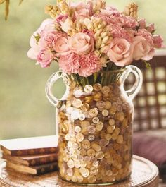 Flower and button centerpiece; change this up for fall flowers and new pennies instead of buttons --copper glam!