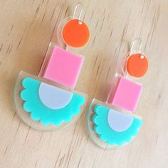 These show-stopping drop earrings are ready to brighten up your night! Made from gorgeous pieces of pretty acrylic, layered on clear acrylic, they are so very lightweight - you wont even know that you have them on. Set with sterling silver plate posts, this striking earrings will become