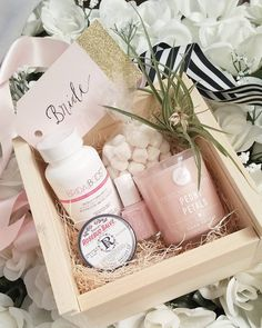 Loving our new Bride-in-a-Box gifts! Champagne gummies rosebud salve floral candle Essie polish and Bridal Boost! #bridalgift #bridalshowergift #bride #customgifts #southerngrownvintage @bridal.boost by southerngrownvintage