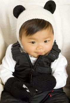 Baby's First Panda Costume - maybe use brown yarn for a teddy bear costume, paw prints on mittens are adorable!