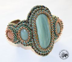 Luscious Imperial Jasper cabochon sits front and center on this bead embroidered cuff bracelet. Simple design and clean lines make this center