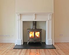 Charnwood Island 2 #woodstove with MDF bespoke mantel and natural slate tiled…