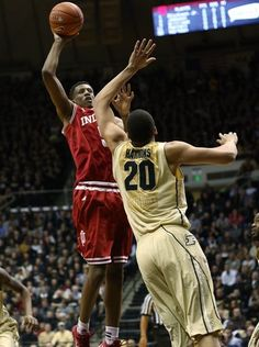 Hoosier Troy Williams scores over Purdue's A.J. Hammons