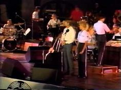 John Denver - From A Distance / Voices That Care (1991) - YouTube.    Heartland Heroes Victory Celebration - Rosenblatt Stadium, Omaha Nebraska John appeared as part of a uniquely special evening, welcoming home our returning Operation Dessert Storm heroes. John was backed by Professor Jimmy & Nightwing, the United States Air Force Strategic Arms Band and the voices of the incomparable Nebraska Gospel Workshop Choir.
