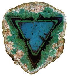 Tourmaline slice in the shape of an inverted triangle which is an ancient symbol of the Goddess.