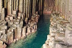 Fingal's cave, Scotland- Like the Giant's Causeway in Northern Ireland, this cave was formed by lava cooling and fracturing over millions of years. The jagged formations on the outside are entirely nature's doing. Places To Travel, Places To See, Travel Destinations, Fingal's Cave, Caves, Sea Cave, Places Around The World, Around The Worlds, Road Trip Uk