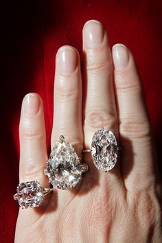 Diamond rings of 9.69 carats (Asscher), 25.47 carats (pear), and 16.04 carats (oval)