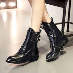 Chiko Pascala Buckled Ankle Strap Combat Boots feature round toe, lace up front, side zipper opening, buckled strap around the ankle, block heel with rubber sole.