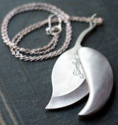 Silver Leaf Hidden Pocket Knife Necklace.  There are a lot of hidden pocket knife items on etsy. Kind of odd.