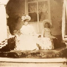 Olga (hidden behind the curtain) Empress Alexandra Feodorovna and Tatiana 1909