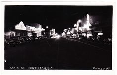 BC – PENTICTON, Main Street at Night, Cameo c.1940s RPPC